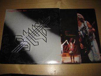 STYX - CAUGHT IN THE ACT.  DUBBEL-LP.