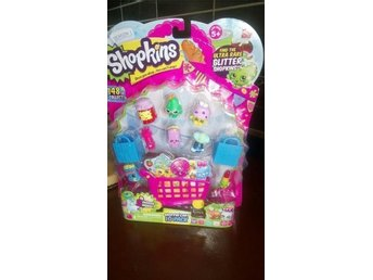 Shopkins Season 1 pack of 10 med liten shopping cart.