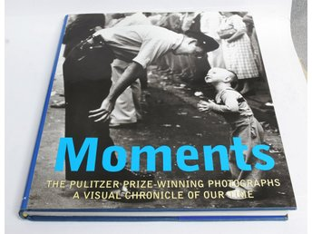 MOMENTS THE PULITZER PRIZE WINNING PHOTOGRAPHS.