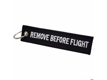 1st Nyckelring Remove before flight (SVART)