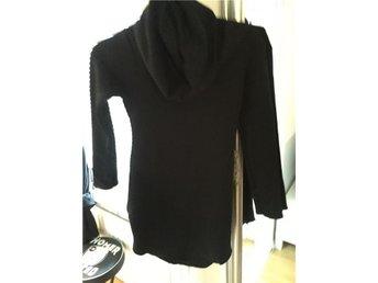 svart poloklänning - Hässelbygård - svart poloklänning - Hässelbygård