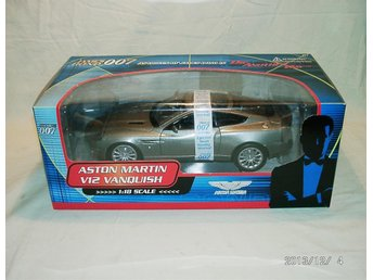 007 DIE ANOTHER DAY. Aston-Martin Vanqish. Minichamps 1:18 - Genarp - 007 DIE ANOTHER DAY. Aston-Martin Vanqish. Minichamps 1:18 - Genarp