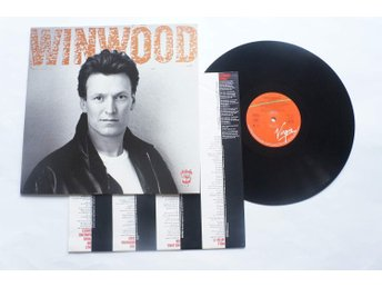 ** Steve Winwood ‎– Roll With It **