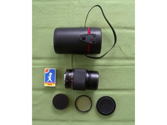 Fint Konica Tele 135 mm 1:3.5 med koger lock samt UV-filter.