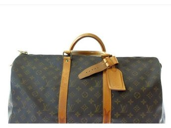 Äkta Louis Vuitton keepall 50   fint skick  med holder och name tag