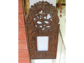 Very old wood frame with Asian motifs.