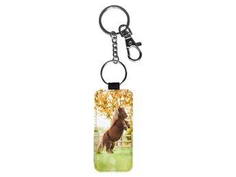 Ny H M nyckelring HM häst ponny väsksmycke (336901078) ᐈ Köp på Tradera ff01f802f6c54