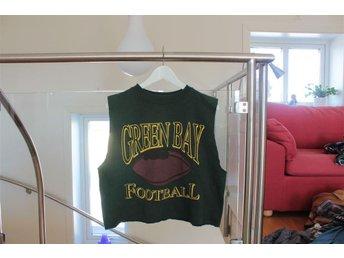 Avklippt grön collegetröja, amerikansk fotboll-logga, storlek M - Sundsvall - Avklippt grön collegetröja, amerikansk fotboll-logga, storlek M - Sundsvall