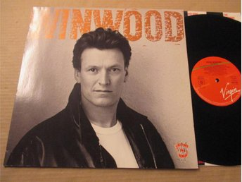 "Steve Winwood ""Roll With It"""
