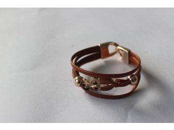 Snyggt Armband i brun läderimitation med uggla fa3d0606b832c