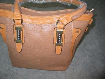 mått på väska med handtag