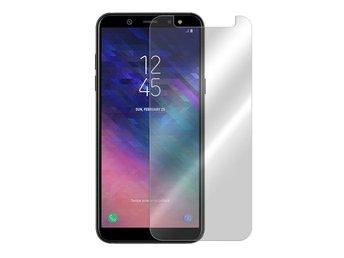 Javascript är inaktiverat. - Halmstad - Skydda din mobilskärm på bästa möjliga sätt med ett skärmskydd i härdat(tempererat) glas.Passar: Samsung Galaxy A6 2018 SM-A600FN/DSFärg: Genomskinlig (Transparent)Tjocklek/Hårdhet: 0.33mm / 9HFörpackning: Retail (hårdplastlåda/kart - Halmstad