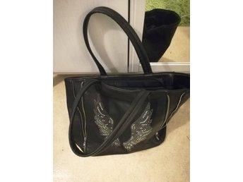 Väska med änglavingar