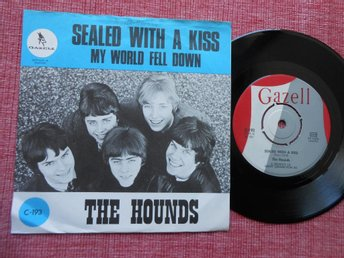 "7"" The Hounds - Sealed With A Kiss / My World Fell Down PS"