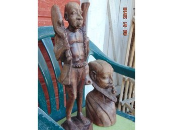 Two large African sculptures - hunter and shaman.