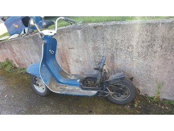 Moped med flinta motor