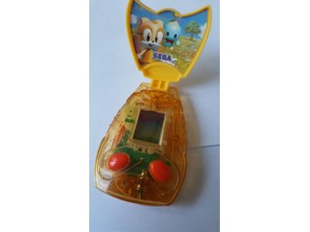 Spel Sega Mc donalds mini game cream flower catch price 2005.