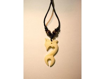 Dragon necklace made out of bone.