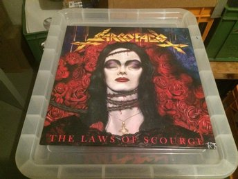 SARCOFAGO. THE LAWS OF SCOURGE.LP RED VINYL.