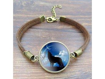 Armband med varg i glas - fint armband av rep - Kramfors - Armband med varg i glas - fint armband av rep - Kramfors